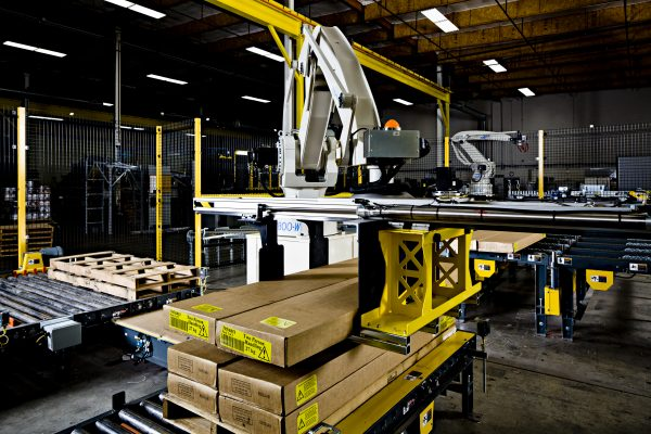 Columbia Okura Robot selecting lumber off a conveyor to palletize.