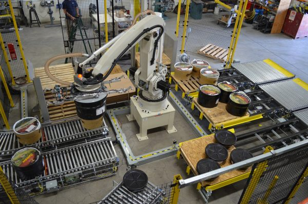 Industrial robot preforming palletizing of products in a warehouse