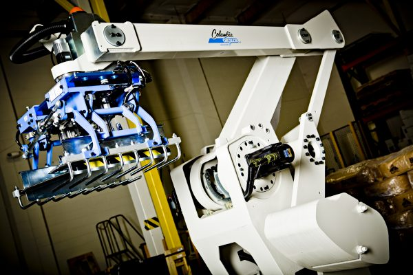 The picture shows the Ai700, a white robotic palletizer
