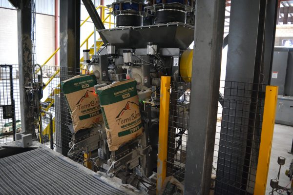 A machine filling in bags