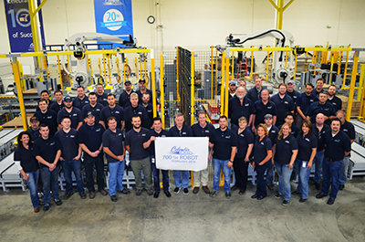 Columbia/Okura staff team photo for 700th robot sale