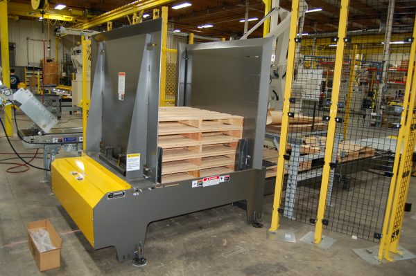 Large yellow and grey pallet dispenser with a set of pallets